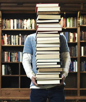 carrying-stack-books